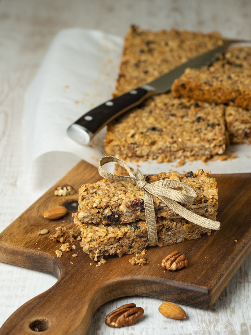 Baked Nut Butter Granola Bars cut and wrapped with a ribbon.