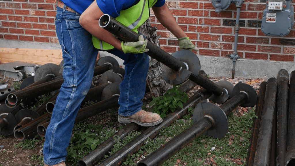 crew installing helical piers
