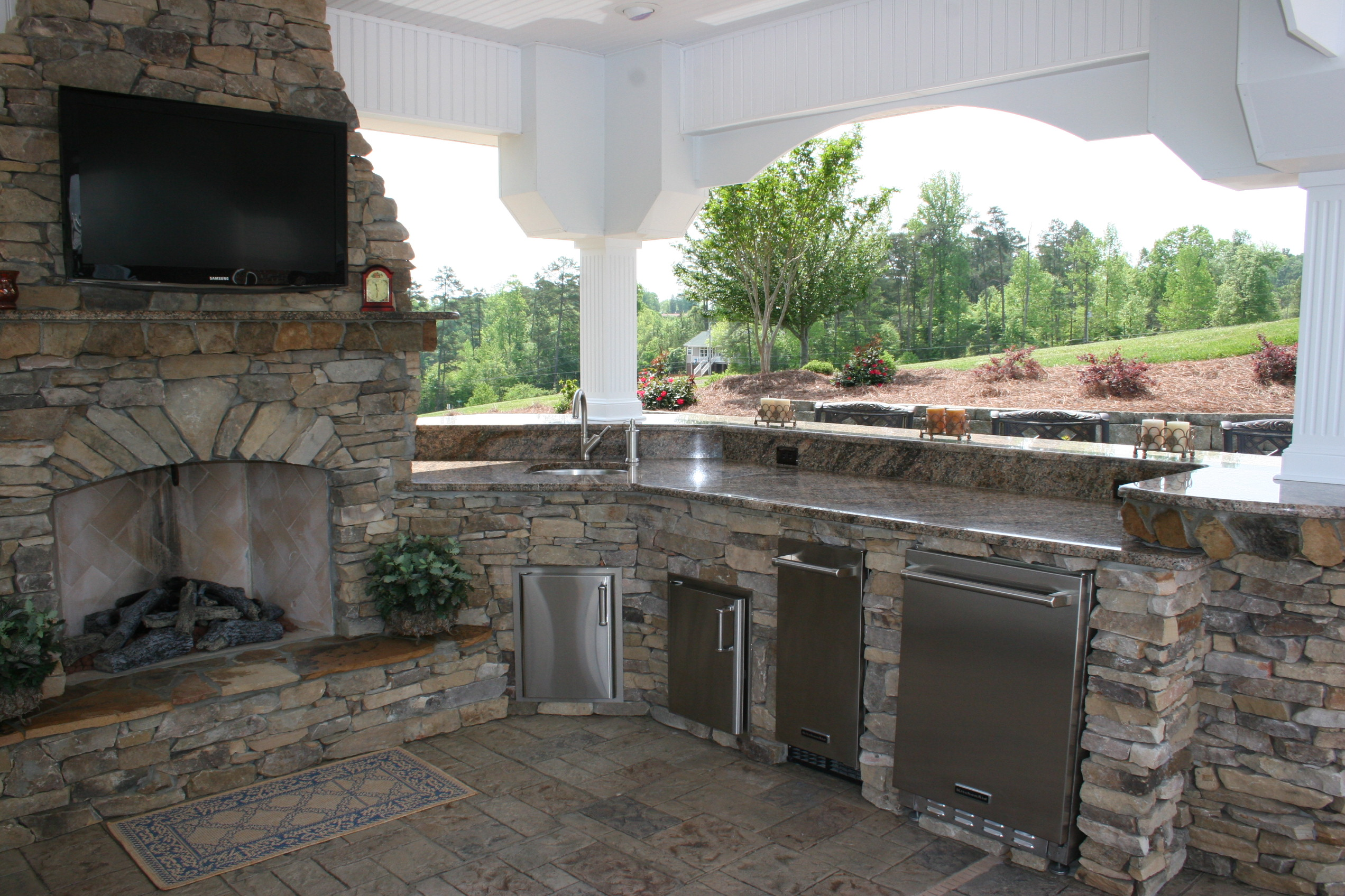 outdoor kitchen with fireplace corner cabinet ideas and