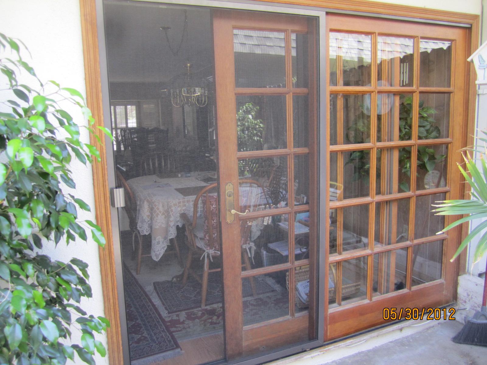 closed sliding patio screen door in