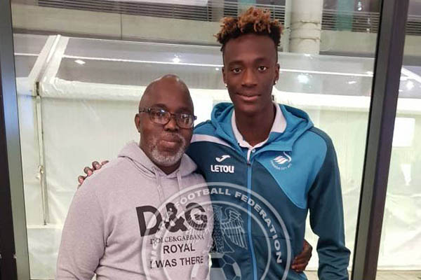 Pinnick Meets Abraham, Confident Swansea Striker Will Make Nigeria Switch