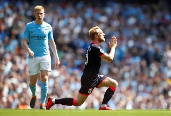 Huddersfield Hold Champions Man City, Delay Record Bid