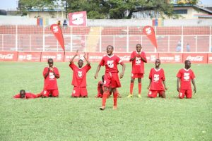 Enugu player moves in to take a penalty shot