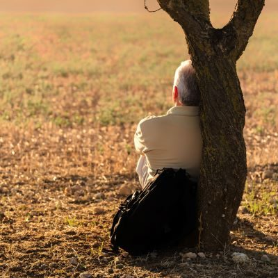 man sitting by tree_cropped featured resource