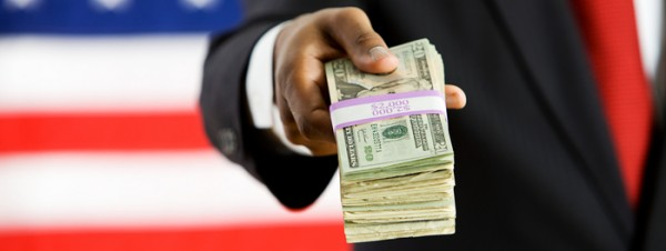 Politician: Holding Out a Stack of Money