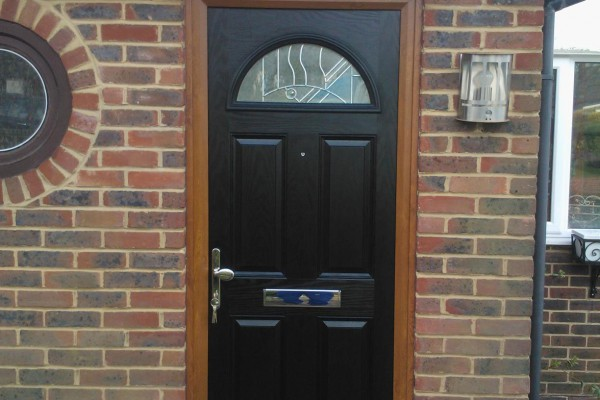 black 4 panel 1 arch Composite Door oak frame