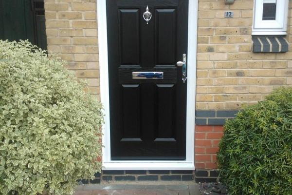 black-4-panel-1-sunburst-global-composite-door 2