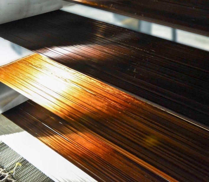 The photo shows carbon fibre being processed at a much higher throughput than is possible with conventional methods