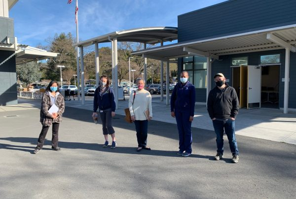 Kathryn Ishizu (Lamorinda Village), Dr. Rebecca Parish (Comprehensive Wellness), Suzy Pak (Community Volunteer), Dr. Denise Hilliard (Comprehensive Wellness), and Jonathan Katayanagi (City of Lafayette) walk the Stanley Middle School site to prepare for the weekend's event.