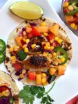 Overhead shot of fish tacos with corn & nectarine salsa