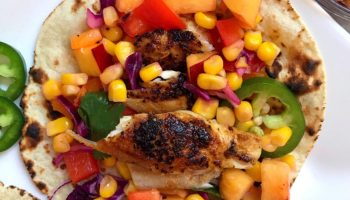 Overhead shot of fish tacos with corn & nectarine salsa