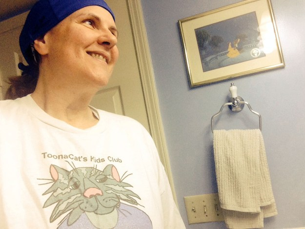 Laurie wears a t-shirt featuring her old cartoon character, ToonaCat from ToonaCat.com