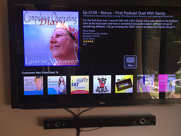 Laurie's podcast logo on the big screen TV via the podcast app on Apple TV