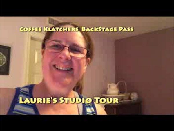 Laurie in her guest room with the caption, Coffee Klatchers' Backstage Pass - Laurie's Studio Tour