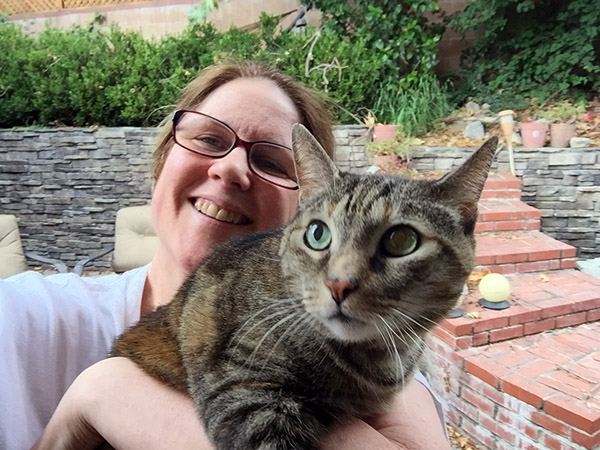 Gracie the tabby cat in Laurie's arms