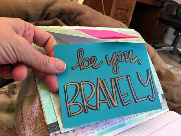 Close up of a hand made note that says be you, BRAVELY