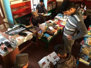 Computaris donations for library in Nepal - Students reading at the library
