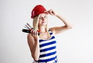 a woman holding tools