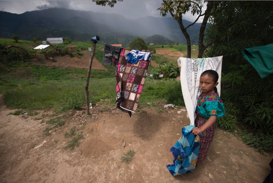 A girl with a 100 dollar bill towel in Pie del Águila, Sacapulas, Quiché, Guatemala. Photo: Santiago Billy/Comvite