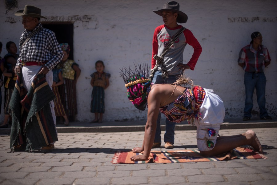 A penitent crawls in San Andrés Sajcabajá, Quiché, Guatemala. Photo: Santiago Billy