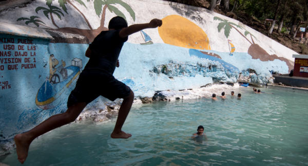 A kid jumps into the main pool in El Balneario de Aguas Calientes y Afrodisíacas, Pastores, Guatemala. Photo: Santiago Billy/Comvite