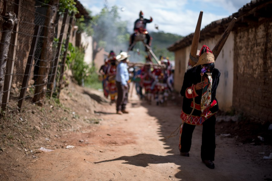 A monkey dancer walks through the streets of Cubulco. Photo: Santiago Billy/Comvite