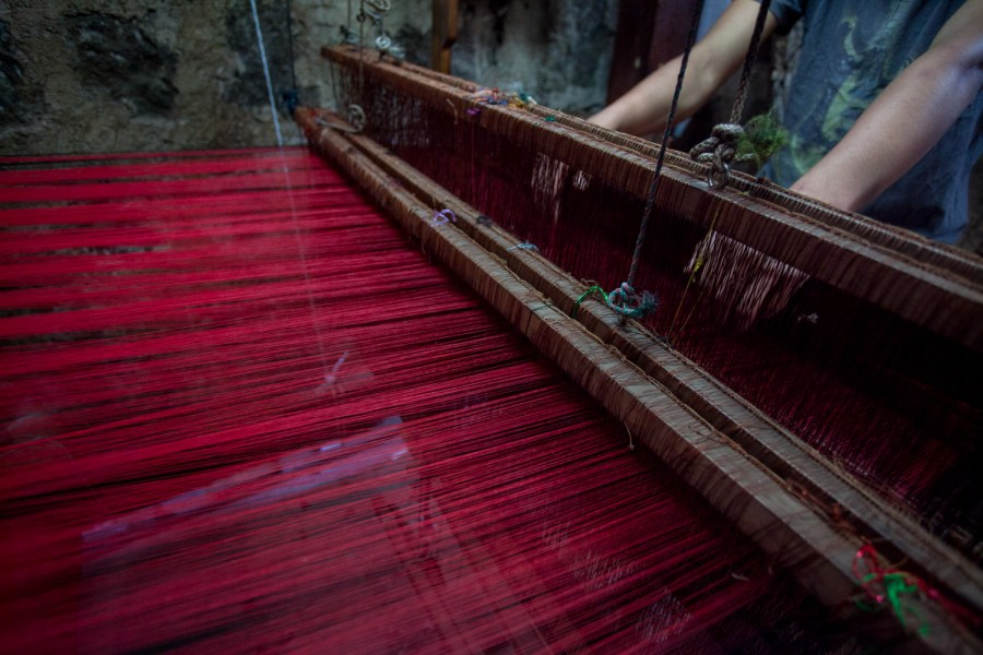A larger piece of textile being woven in a medieval foot pedal loom in Santiago Atitlán. Photo: Jeff Abbot/comvite