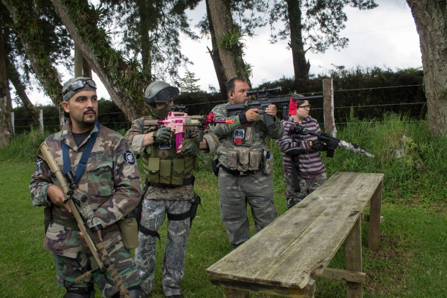Airsoft players test their weapons before a match in Guatemala. Photo: José Hernández Moll