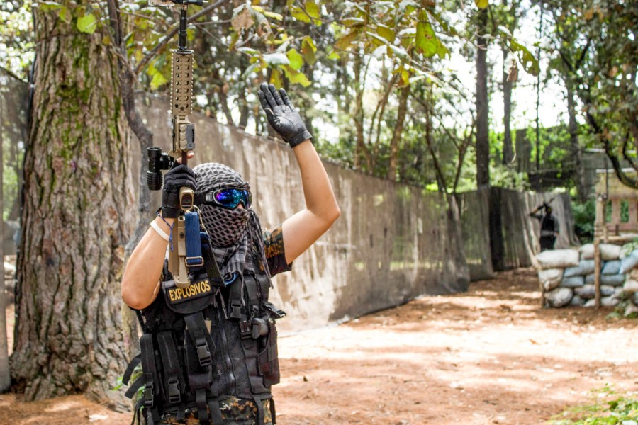 "A player is ""killed"" during a match of airsoft in Guatemala. Photo: José Hernández Moll"