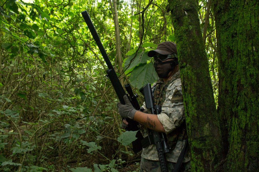 An airsoft sniper camps in the woods while waiting for targets. Photo: José Hernández Moll