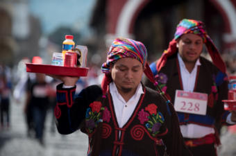 Runners during the Race of The Trays sporting a traditional look from Chichicastenango. In La Antigua Guatemala. Photo: Santiago Billy/Comvite