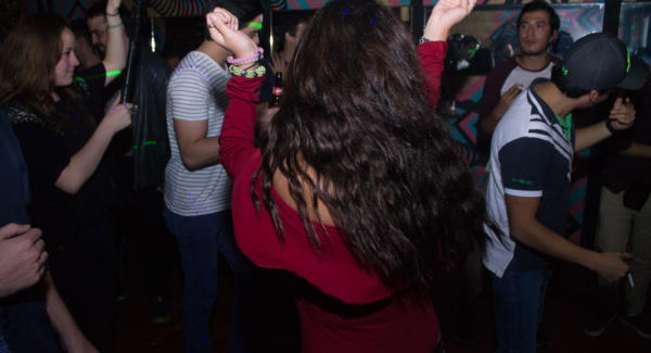 Audience members dance to House music in a small venue in Guatemala City. Photo: Jose Hernández/Comvite