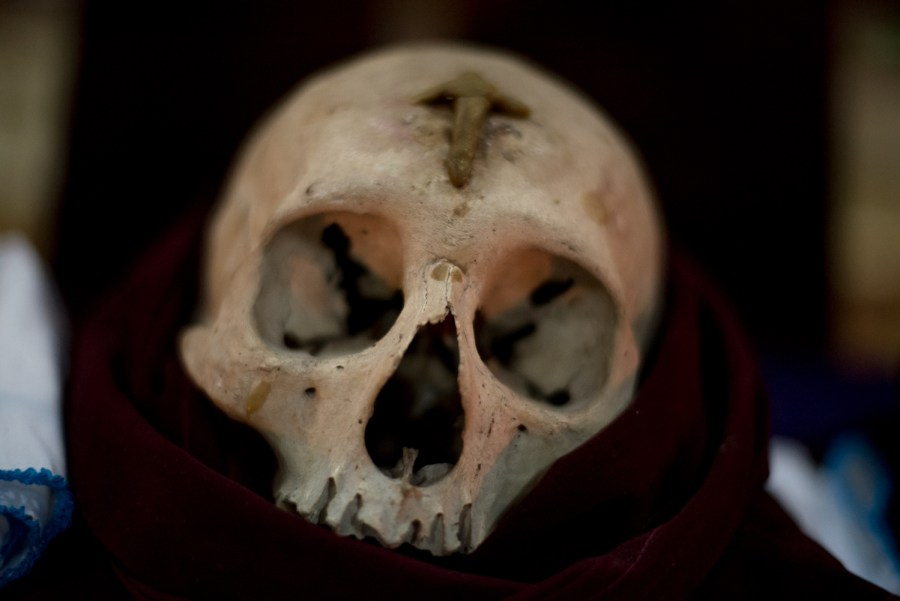 A skull of unknown origin that's used in part of a Maya-Itzá procession in northern Guatemala. Photo: Santiago Billy/Comvite
