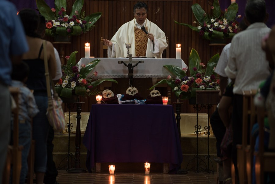 A priest during mass conmemorating All Saints Day in San José, Petén, northern Guatemala. Photo: Santiago Billy/Comvite