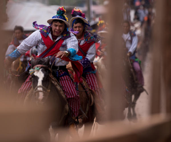 Riders calm their horses once they arrive at the end of the track. Photo: Santiago Billy/Comvite