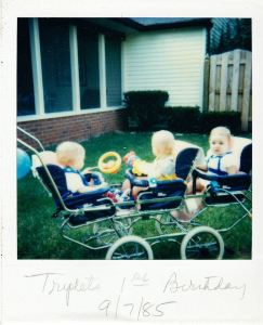 my brothers and I in our groovy triple stroller