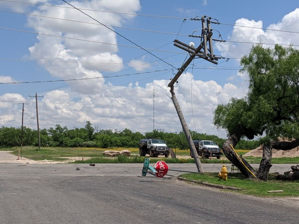 Republic Services truck knocks down power lines