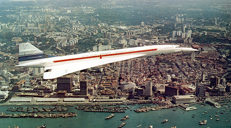 An amazing view of Concorde 002 over the old city. The city 45 years ago, was seeing several of its first generation skyscrapers coming up. Some of the iconic buildings seen in this photograph include the former MSA (later SIA) Building, former Robina House, and a partially completed 3rd Ocean Building (now replaced by the Ocean Financial Centre) (photo souce: online at http://www.concordesst.com/).