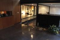 Refurbishing A Black Concrete Floor In A Modern Home