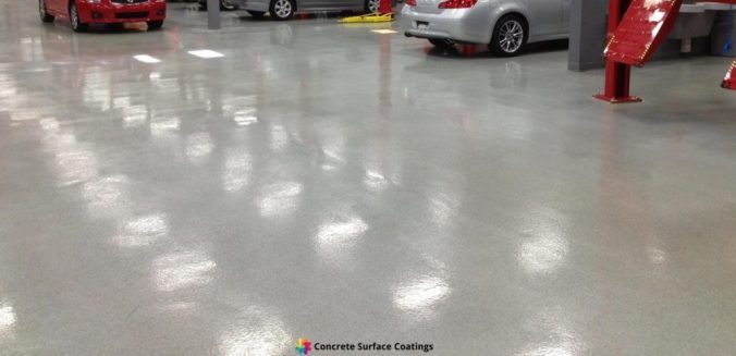 A light grey epoxy floor coating in a panel beating workshop