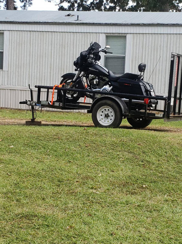 Black motorcycle on a trailer