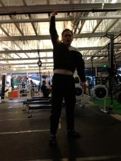 step four: stand up and hold the barbell over your head.