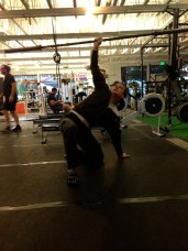 step three: get up onto your knee. Don't kid yourself. That barbell is getting heavy.