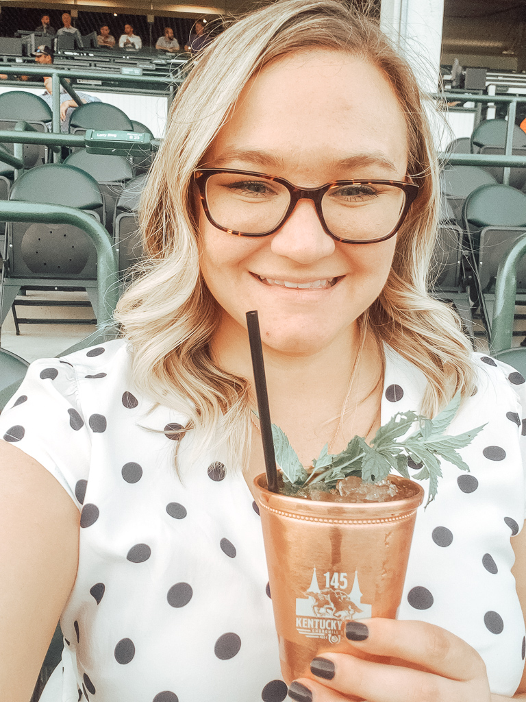 Sarah sipping Mint Julep in copper cup