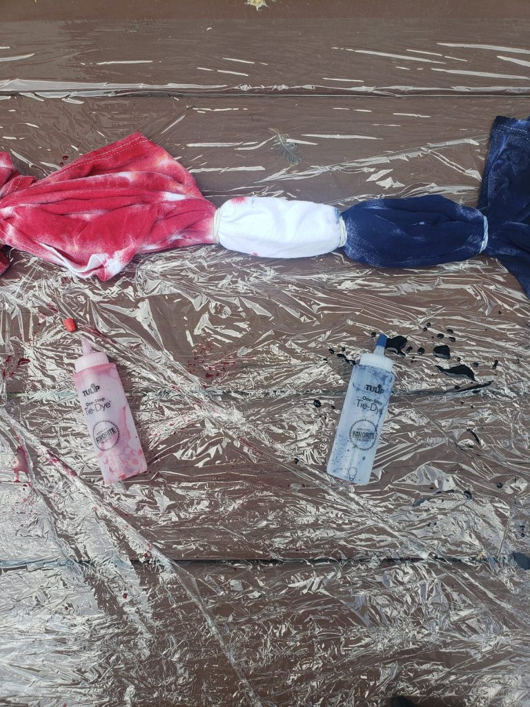T-shirt with dye design applied and empty bottles