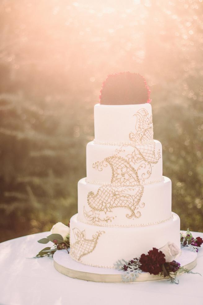 Burgundy Gold And White Scroll Wedding Cake
