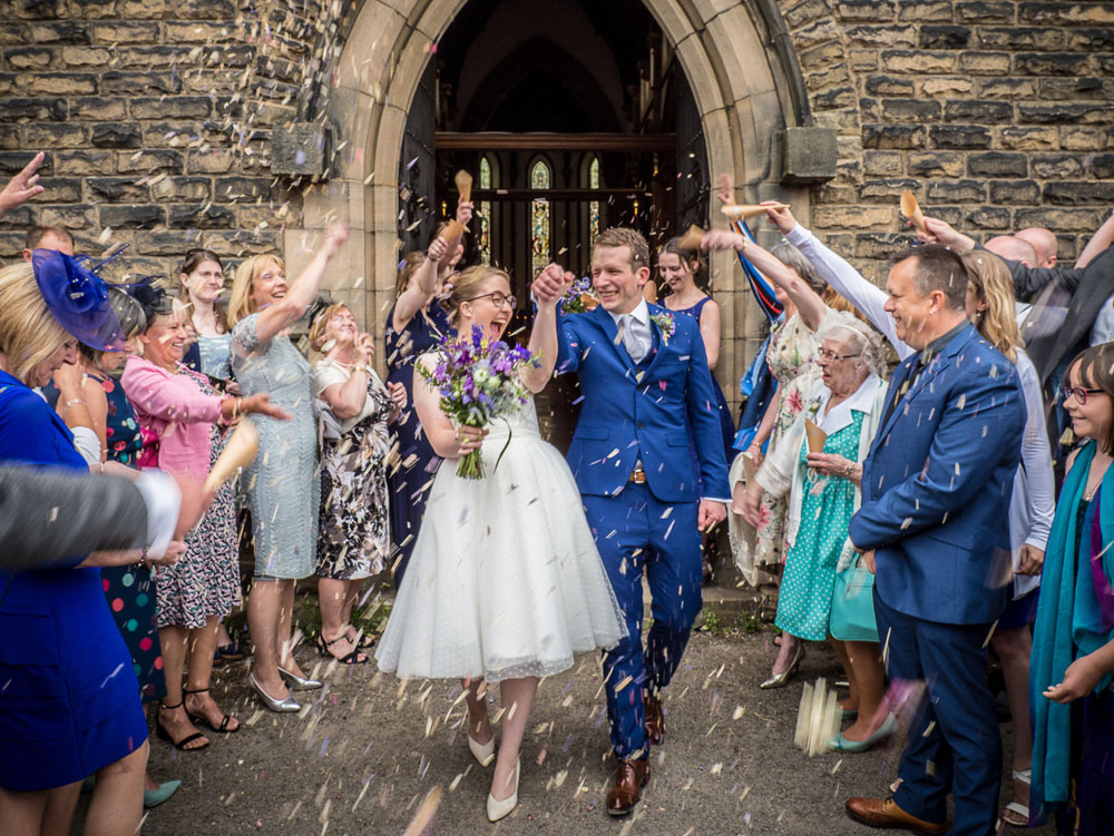 Delphinium Petal Confetti Moment - guests outside the church door