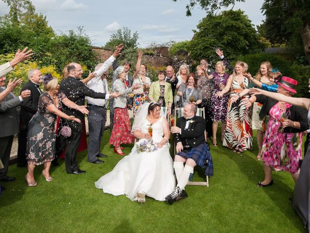 Confetti Moment - all the guests gathered round in the garden