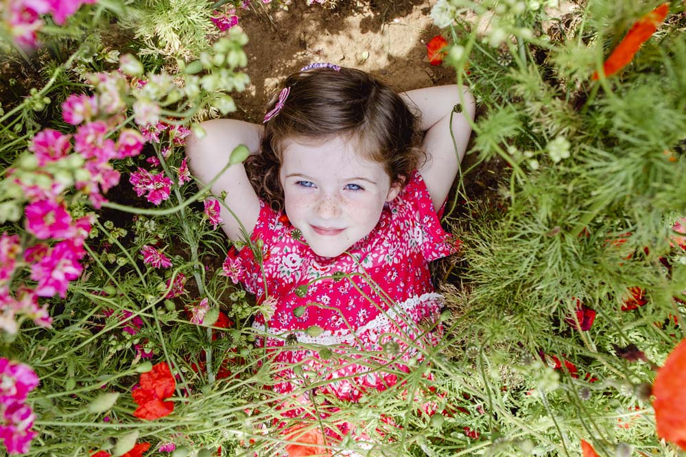 Little girl in the flowers, Photo by Laura Truby Photography, The Confetti Flower Field, 2019.