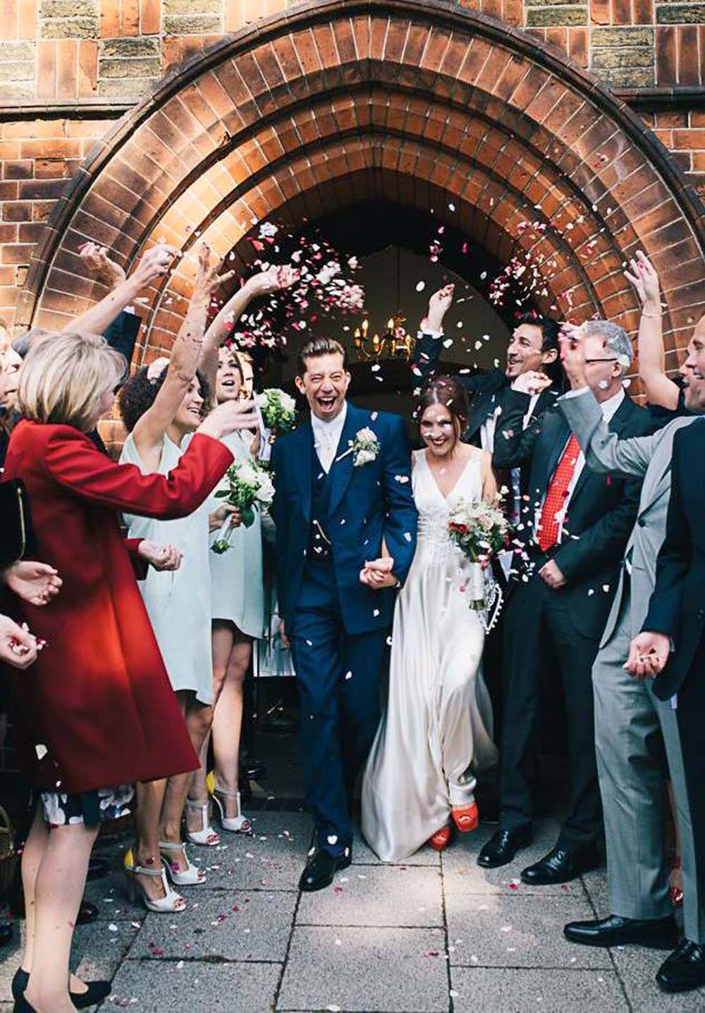 The confetti moment right outside the church door, with Rainbow Small Natural Rose Petals